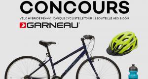Un vélo Louis Garneau avec casque et bouteille